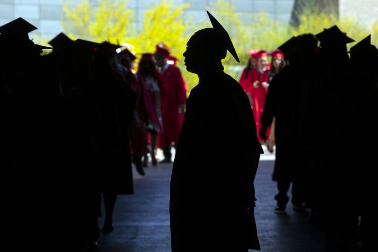 A silhouette of a UNLV graduate.