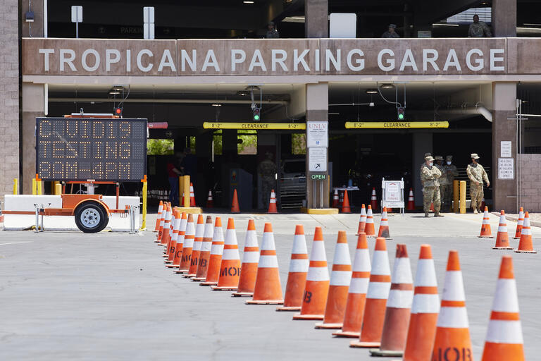 Cones lined up in front of parking garage entrance