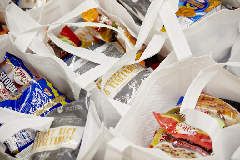 white bags filled with food