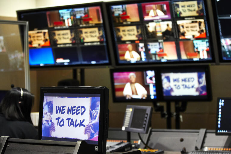 """Television screens showing """"We Need to Talk"""" panelists in a studio"""