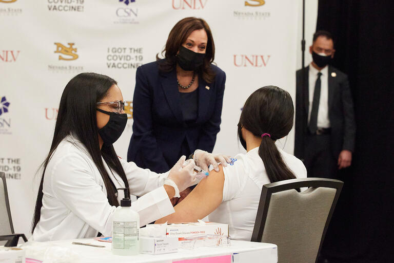 vice president kamala harris watches unlv student administer COVID vaccine to another local college student