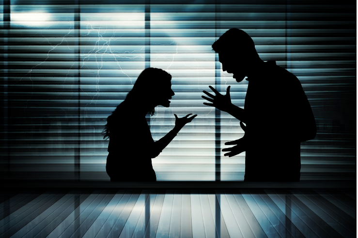 silhouette of man and woman arguing