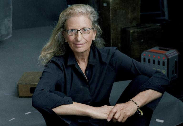 Annie Leibovitz seated on floor