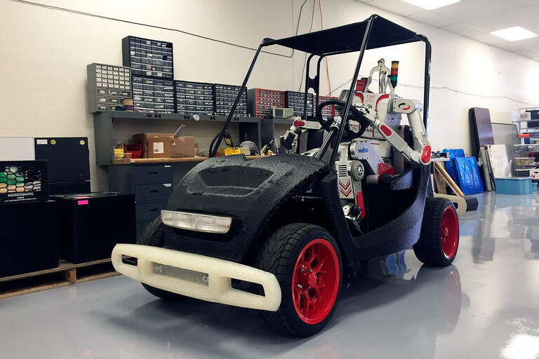 Metal Rebel behind the wheel of Local Motors' 3D-printed LOCO vehicle