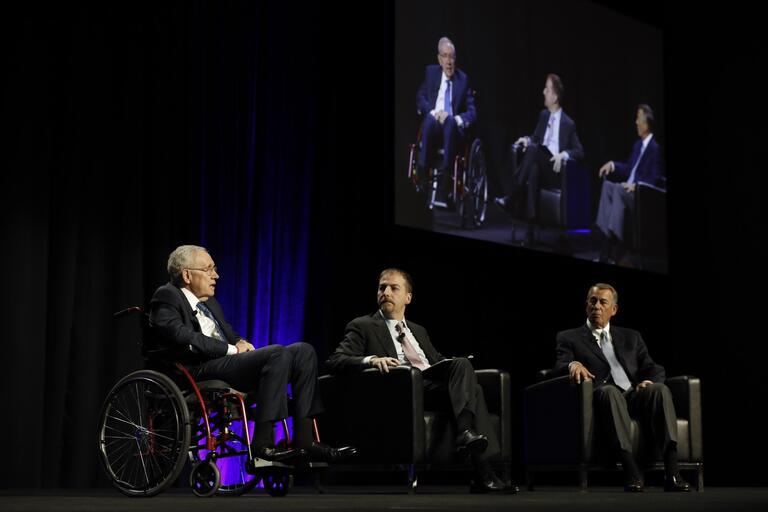 Chuck Todd, host of NBC's Meet the Press, moderates a discussion at the Bellagio in Las Vegas between former U.S. Sen. Harry Reid and former Speaker of the House John Boehner.