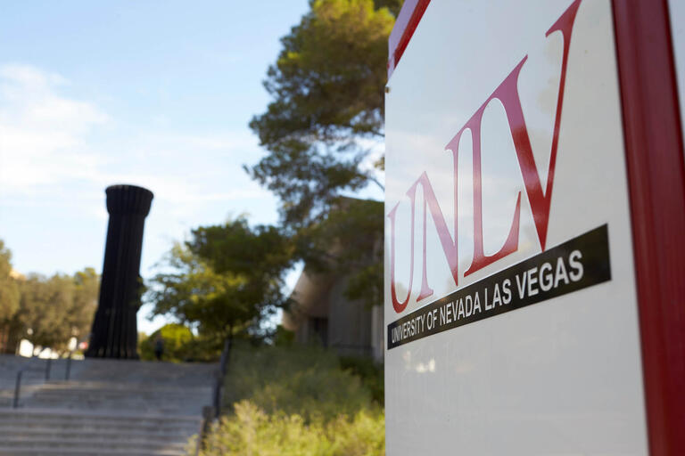 The Flashlight is seen from a distance with a UNLV sign in the foreground