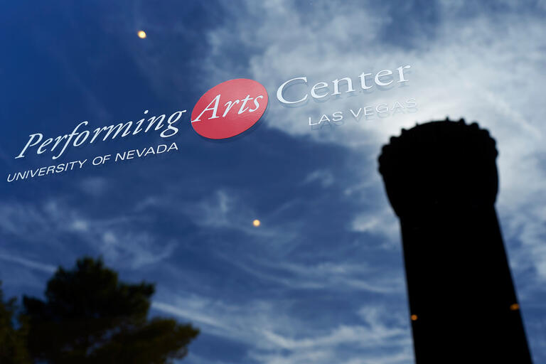 """UNLV's """"Flashlight"""" is reflected in the window of the Performing Arts Center"""