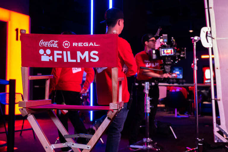 director's chair with film crew in background