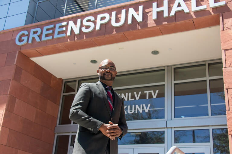 Ashton Ridley standing outside UNLV's Greenspun Hall