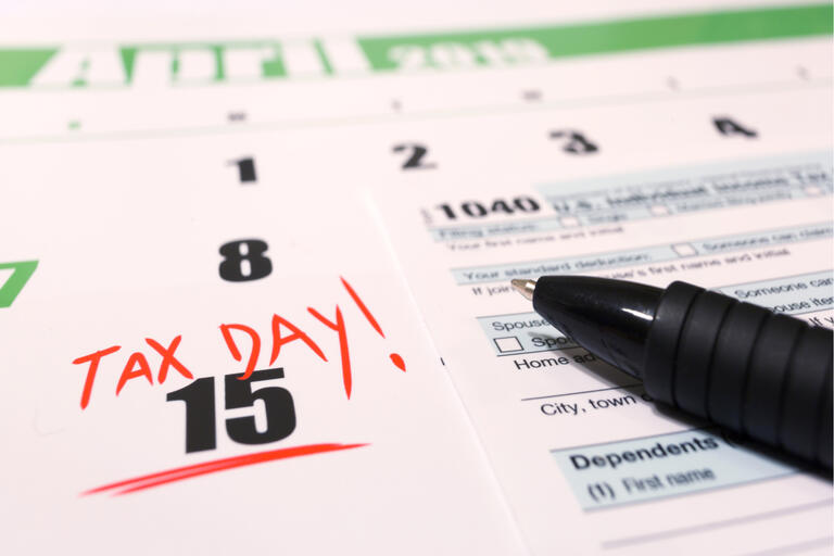 An image of a 1040 from and a calendar that highlights April 15, 2019 as tax day.