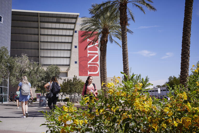 Students walking in front of UNLV's Lied Library