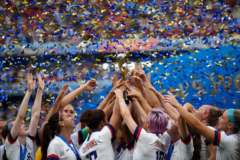 U.S. National Women's Soccer Team lifts FIFA World Cup 2019 trophy as confetti and streamers rain down