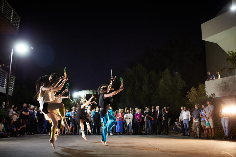 dancers outdoors at night