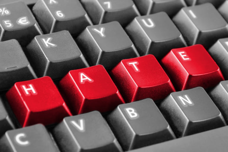 closeup of computer keyboard with HATE spelled out in red letters