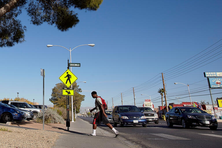 pedestrian exiting a crosswalk on Maryland Parkway