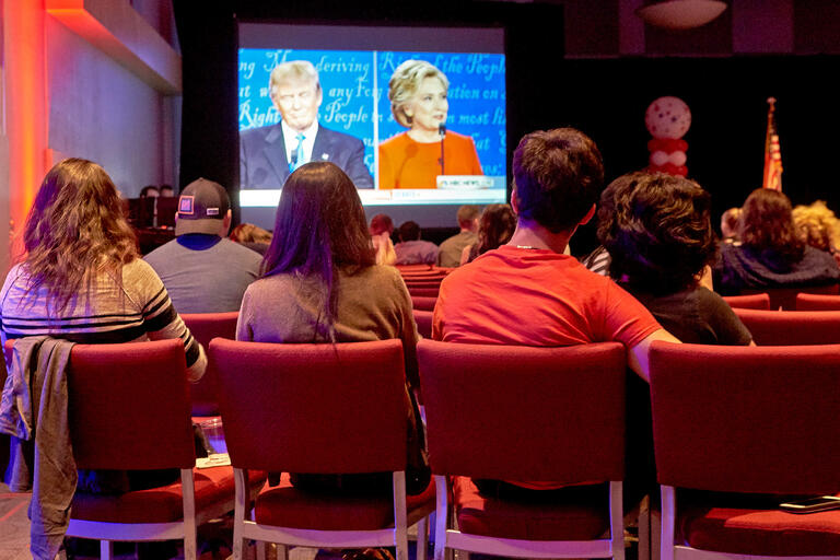 Students watch the first presidential debate in the Student Union