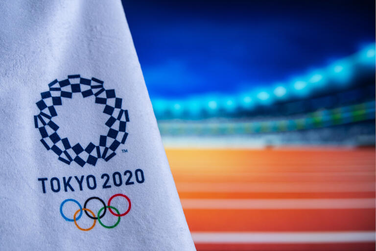 flag emblazoned with Tokyo 2020 and Olympic rings