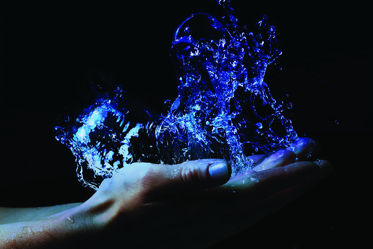 water splahes on an open hand