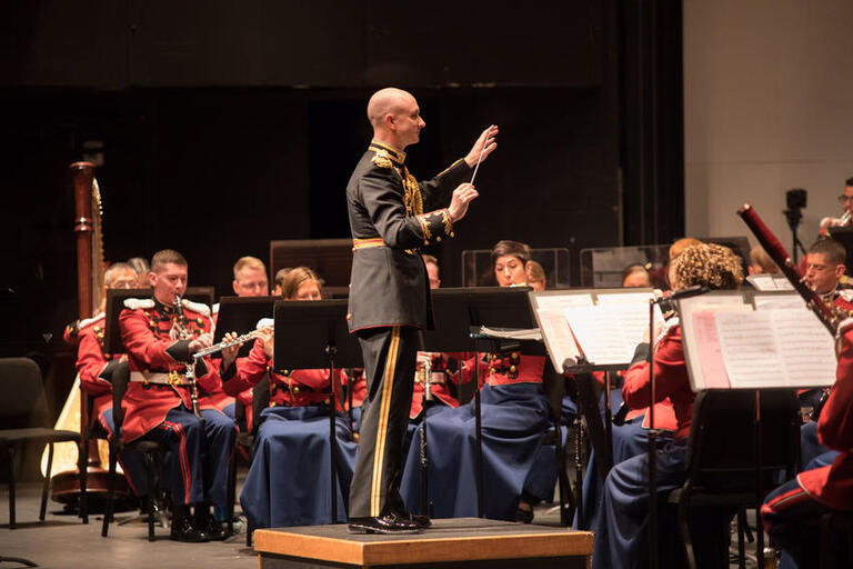 marine band conductor and musicians on stage