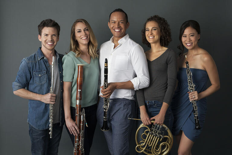 five musicians with wind instruments