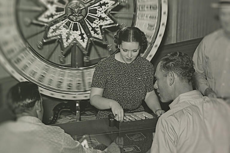 An unidentified woman works the wheel at the Hotel Apache and Casino in downtown Las Vegas, circa 1940.