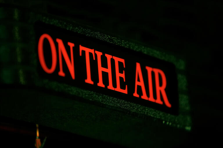Lighted sign that says On the Air