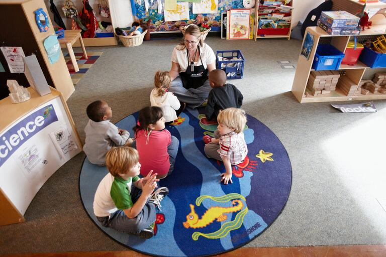 Children play inside the preschool
