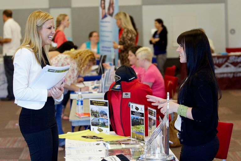 Student visits a table at Career Fair