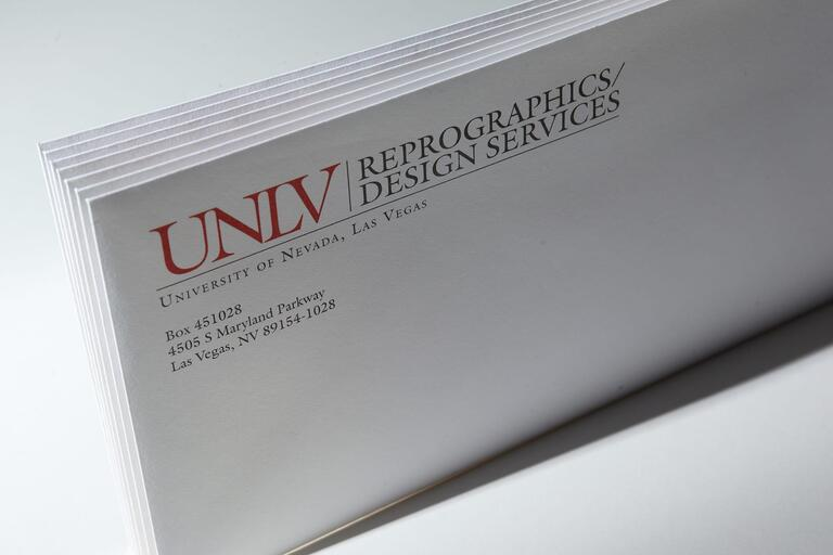 Set of envelopes with Reprographics logo