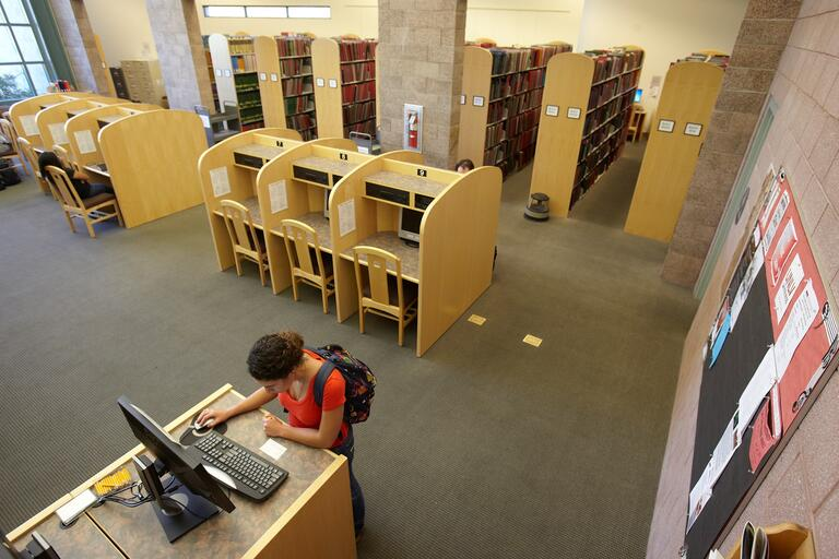 A student accesses the computer kiosk inside the music library.