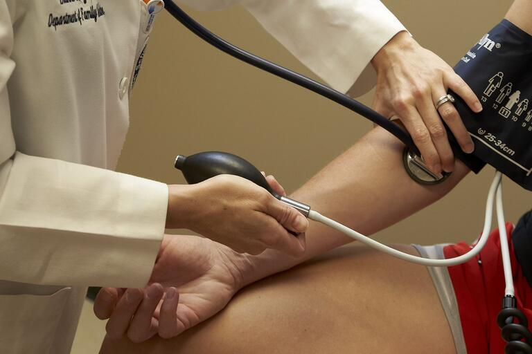 Closeup of patient receiving a blood pressure test