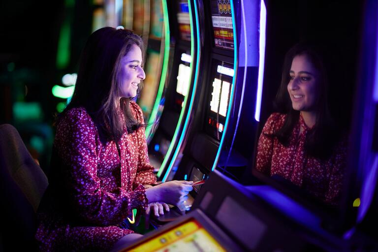 Jasmine Nemati sitting at a gambling macine