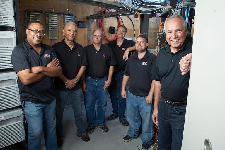 Group photo of telecommunications staff