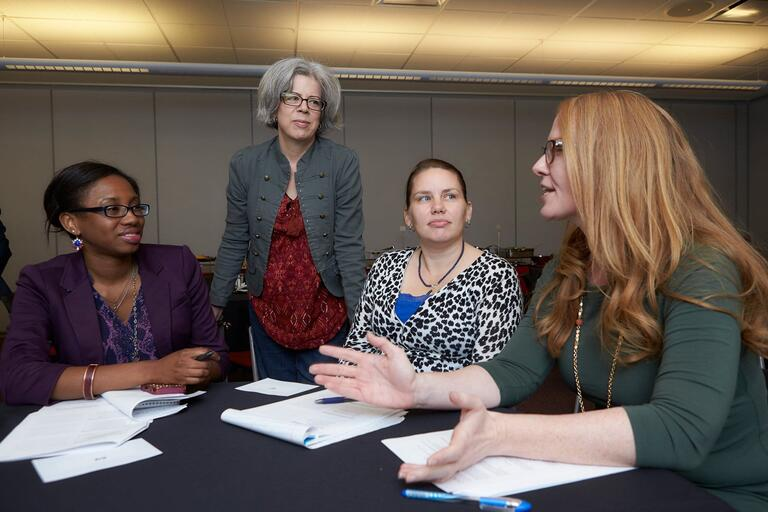 Members of the Women's Council conduct a meeting