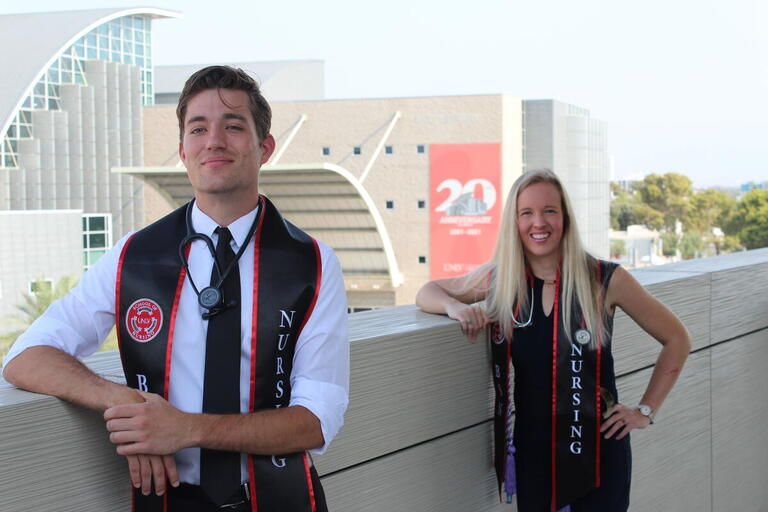 nursing students pose with nursing school stoles and stethoscopes