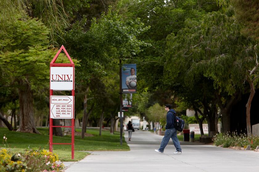 Students walk along large sidewalk