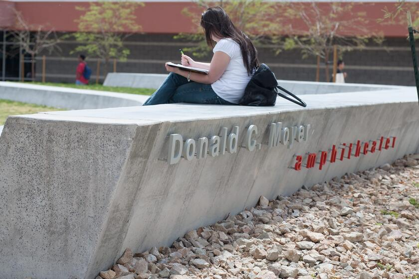Student sits at Moyer Amphitheater