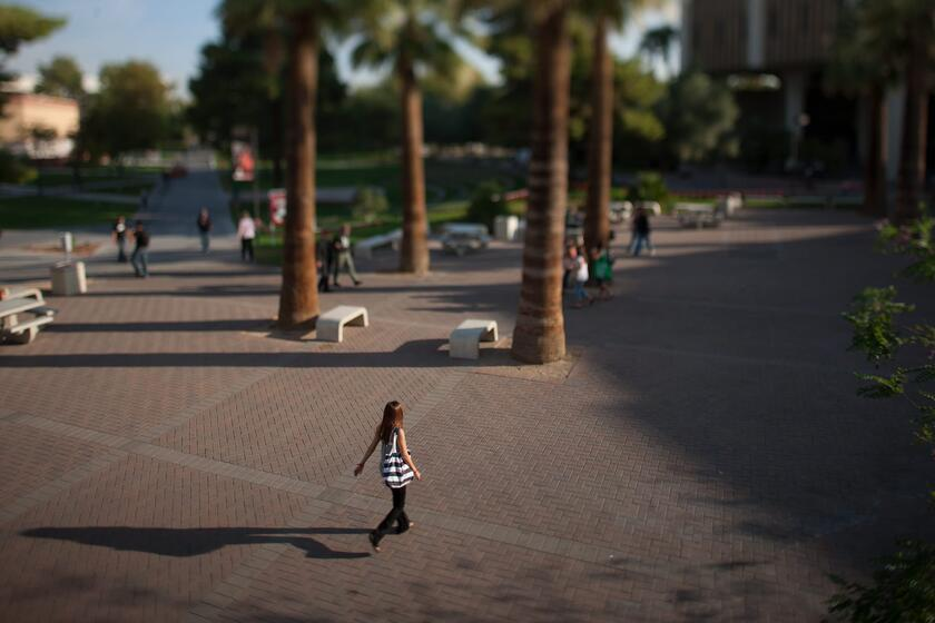 Student walks across Valerie Pida Plaza