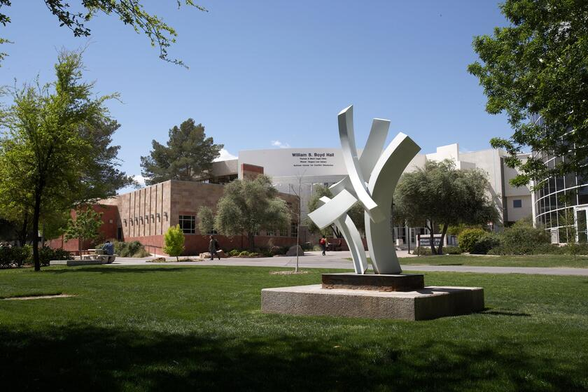 White sculpture stands in grassy area