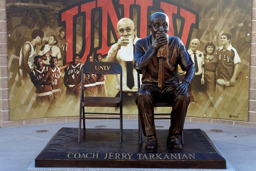 Bronze statue of Jerry Taranian sitting on chair