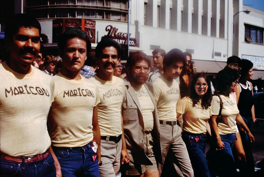 Participants in the Christopher Street West Pride parade wearing maricón t-shirts