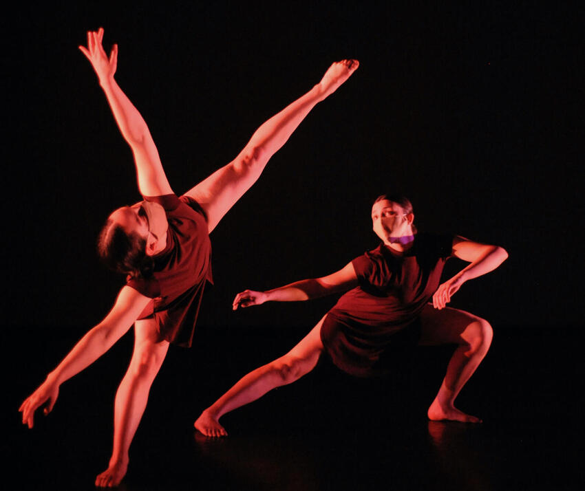 Two dancers dancing.