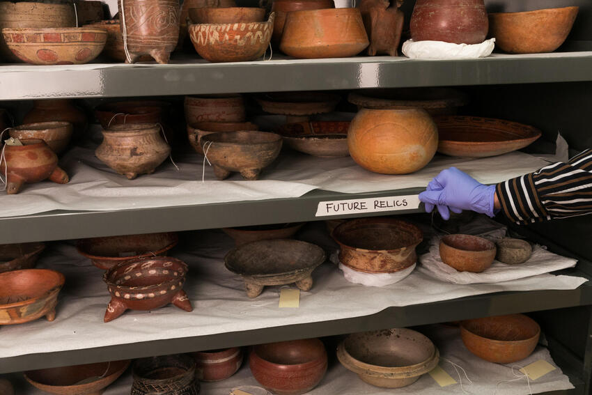 Pottery and relics on a shelf with the label that says Future Relics