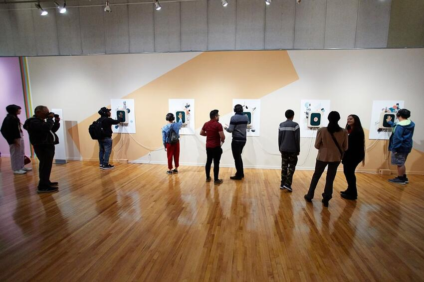 Students viewing art at the Barrick Museum
