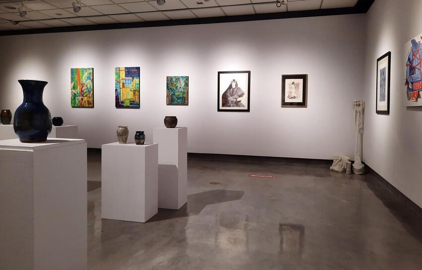 Various art pieces in a gallery.