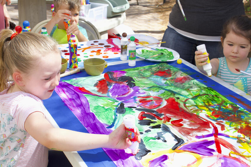 Children painting together.