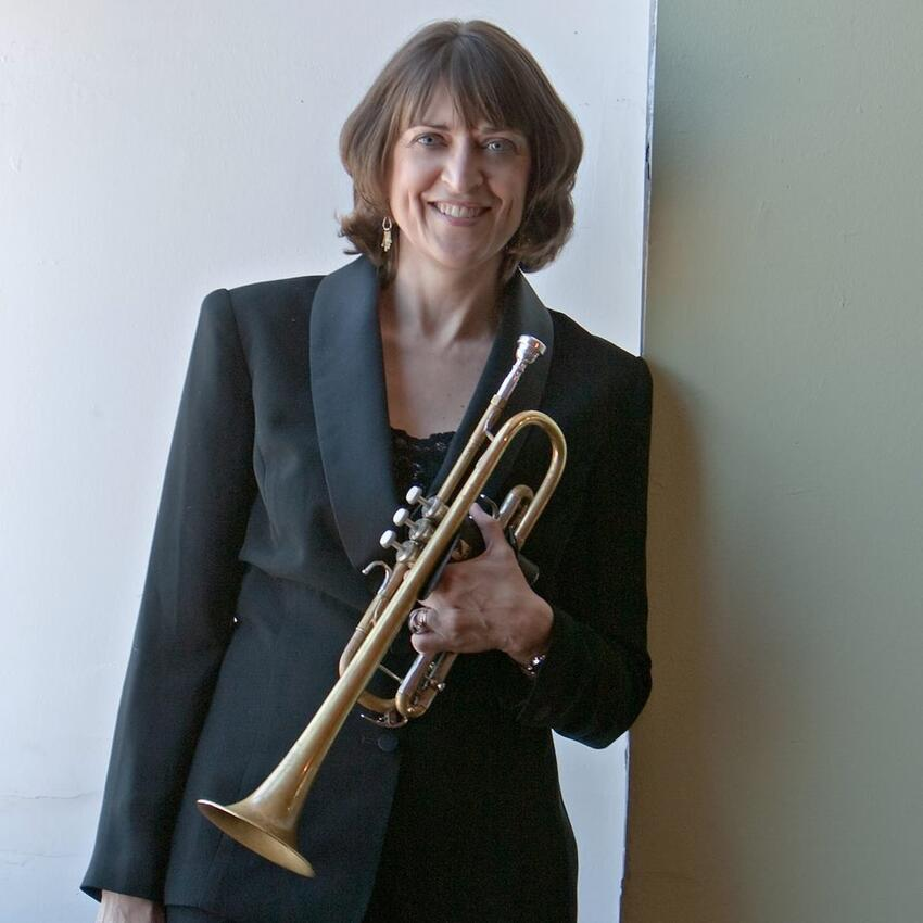 Barbara Hull holding her trumpet