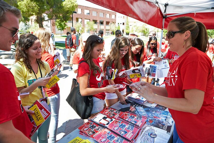 Students collecting information at a booth