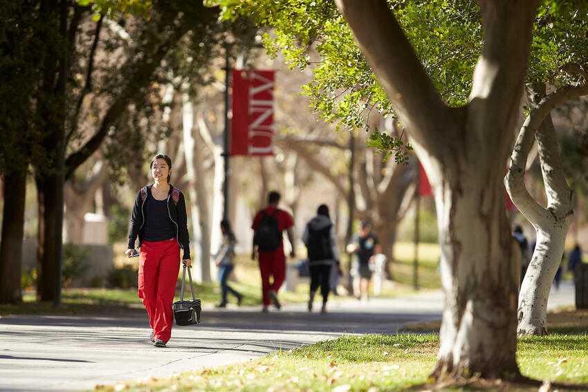 Student walks outside on campus