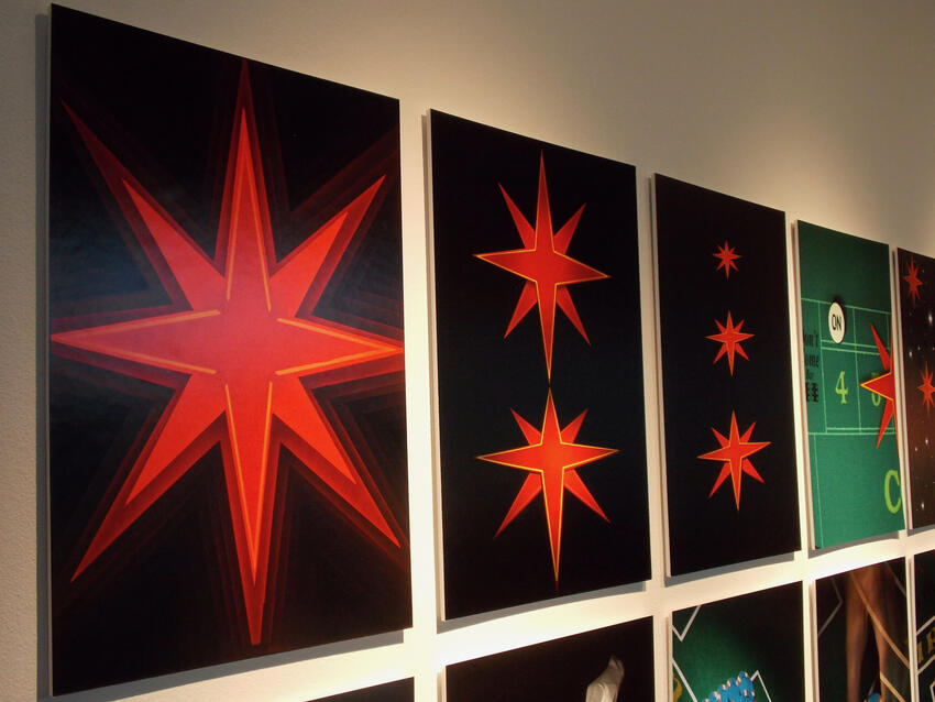 Vegas Star paintings hanging in a gallery